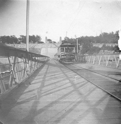 A trolley car of Niagara Falls Park and River Railway crossing Queenston-Lewiston Suspension Bridge