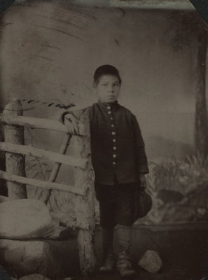 Portrait of a young Indian boy from Shingwauk Mission