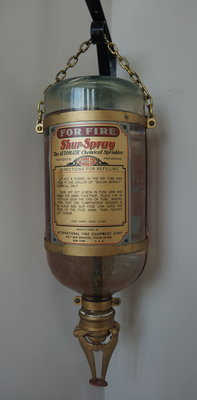 Shur-Spray glass fire extinguisher