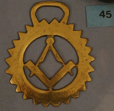 Antique horse brass with masonic design