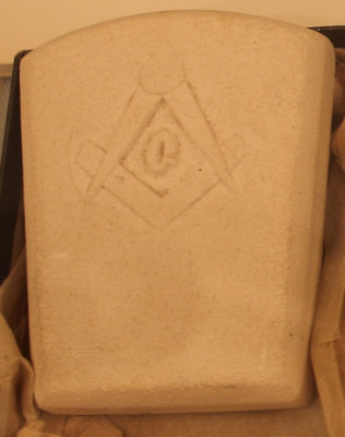 Stone embossed with the square and compasses