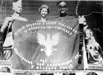 Elizabeth C. Ascher with two Polish soldiers