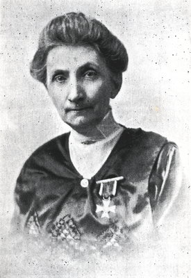 Elizabeth C. Ascher decorated with the Chevalier's Cross of the Order of Polonia Restituta