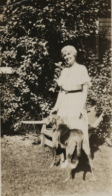 Photograph of unidentified woman and dog
