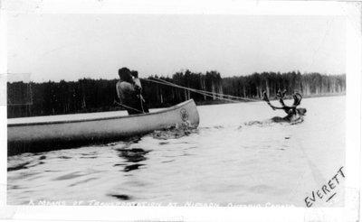 Nipigon, caribou pulling canoe.