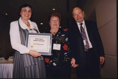 Hazel Thornton-Lazier receives Ontario Library Trustees' Association award from 1999 OLTA President Audrey Lawrence and 2000 OLTA President Robin Dunbar
