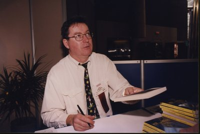 Eric Walters, winner of 1999 Silver Birch award, signing books at Super Conference 2000