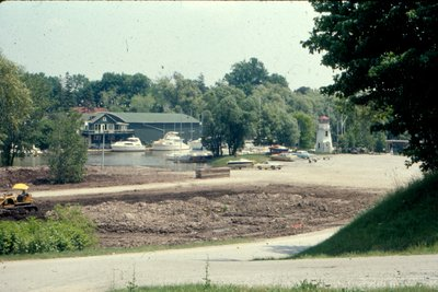 "<font color=""white"" face=""verdana"">Oakville Harbour marina under construction, courtesy of the Town of Oakville"