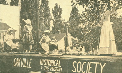 "<font color=""white"" face=""verdana"">Oakville Historical Society and Museum Centennial parade float"