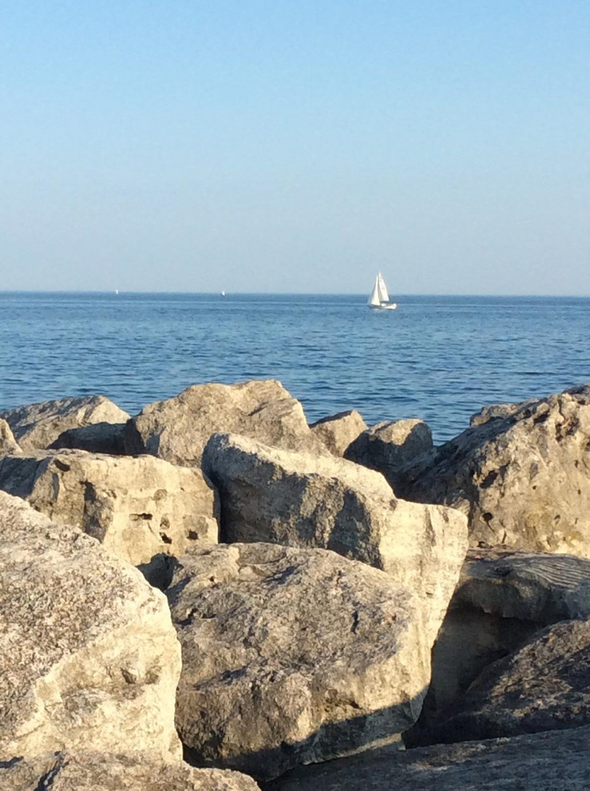 Sailboat in the distance from Bronte Harbour