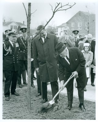 Lt/Gov. Rowe and MPP Jim Snow Planting a Memorial Tree.