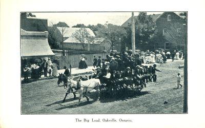 """The Big Load"" on Main Street Postcard"