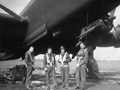 Flight Lieutenant John Cooper, Pilot (right) standing under a Halifax III Bomber Aircraft.