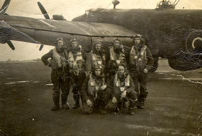 Don Bastead (back row, far right) in early 1945 with the crew of the 432 Leaside Squadron, East Moore, Yorkshire, standing beside a Halifax aircraft.