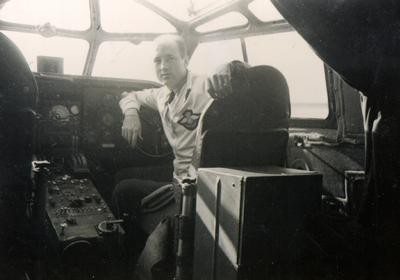 Jack Wyndham, Radio Navigator for the Royal Air Force Ferry Command inside a flying boat at Boucherville, Quebec, 1942