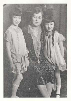 Unidentified woman with 2 young girls
