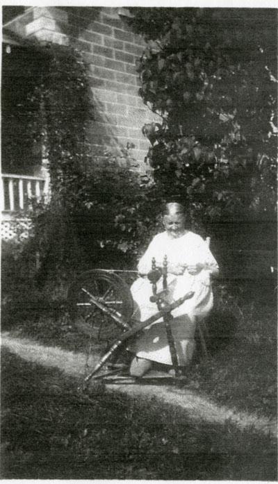 Mrs. August Gutzman and Spinning Wheel