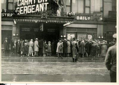 """Photograph of opening of Motion Picture """"Carry on, Sergeant""""in Toronto at the old Regent Theatre."""