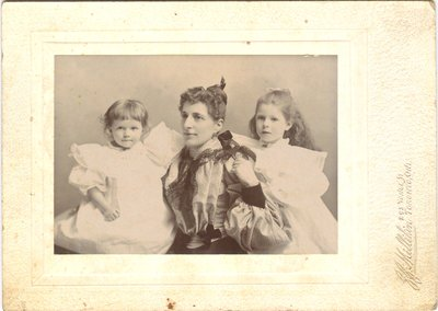 Photograph of a woman and two girls