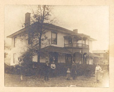 Amos Wright family on the front lawn of the house built by Abraham Law