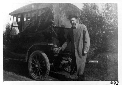 A member of Savage family and his Ford Model T