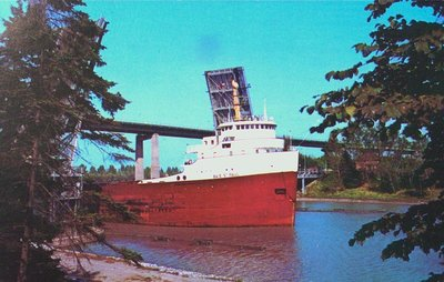 A Freighter Passing Underneath the Garden City Skyway on the Welland Ship Canal