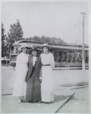 A Trio of Ladies In Front of an NS&T Car