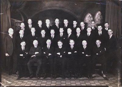 A Formal Shot of 28 Men Inside Welland Avenue Church