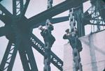 Two Men Working on Chains of a Vertical Lift Bridge