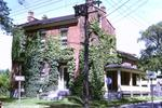 A house at the corner of Trafalgar and Yates Street