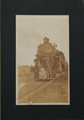 Photograph of Men on Train
