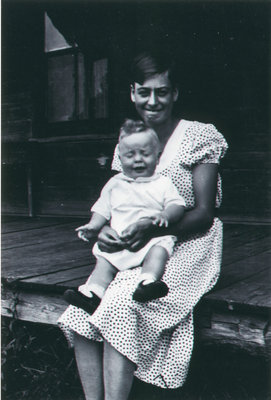 Alma with unknown baby on verandah