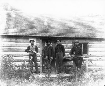 Hunters in Front of Log House
