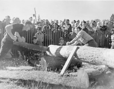 Two Men Hand-sawing a Log, South River Agricultural Society Fall Fair, circa 1960