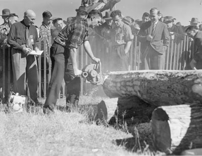 Man in Chainsaw Competition, South River Agricultural Society Fall Fair, circa 1960