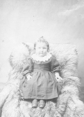 Portrait of a Young Girl Sitting in Fur