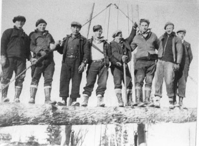 Loggers Standing on Log, South River Area, circa 1950