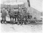 Two Horses Pulling a Sled with Three Children Riding, circa 1920