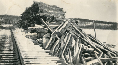 Logs Next to the Railroad Tracks, March 2, 1941