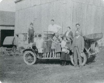 Bow Family & Friends on a Car at the Bow Farm, circa 1920