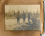 Three Men Standing Beside a Sawhorse, circa 1920