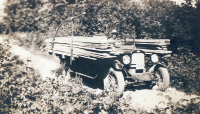 Ira Dahms Delivering a Load of Lumber