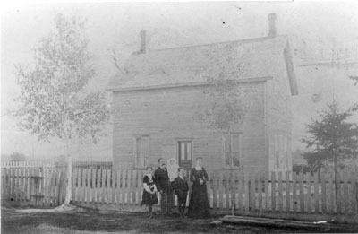 Family in Front of a House, circa 1890