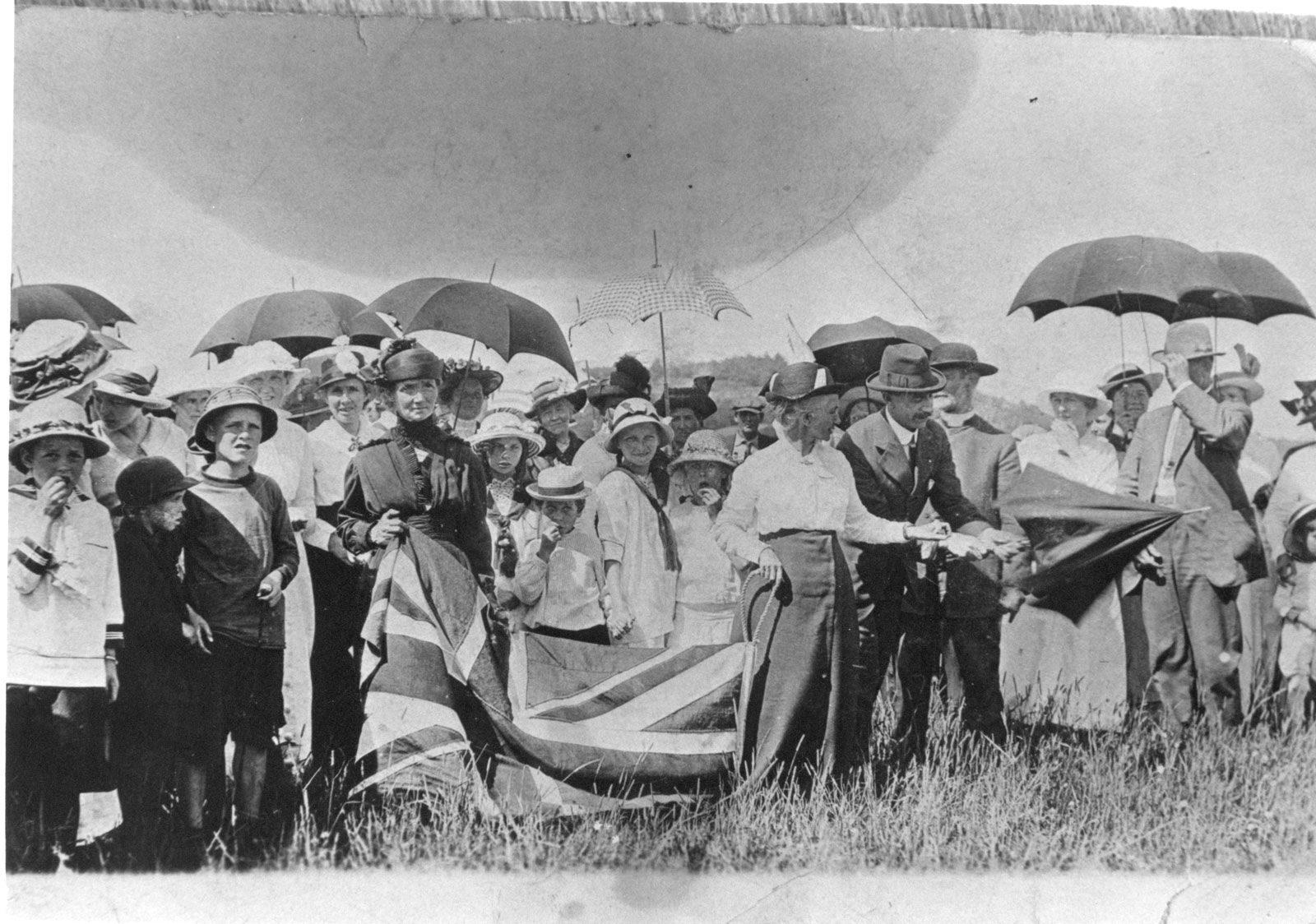 Women and children gather in a field with a Union Jack to present it to the 162nd Battalion in 1915. <br>Courtesy the Sundridge - Strong Union Public Library.