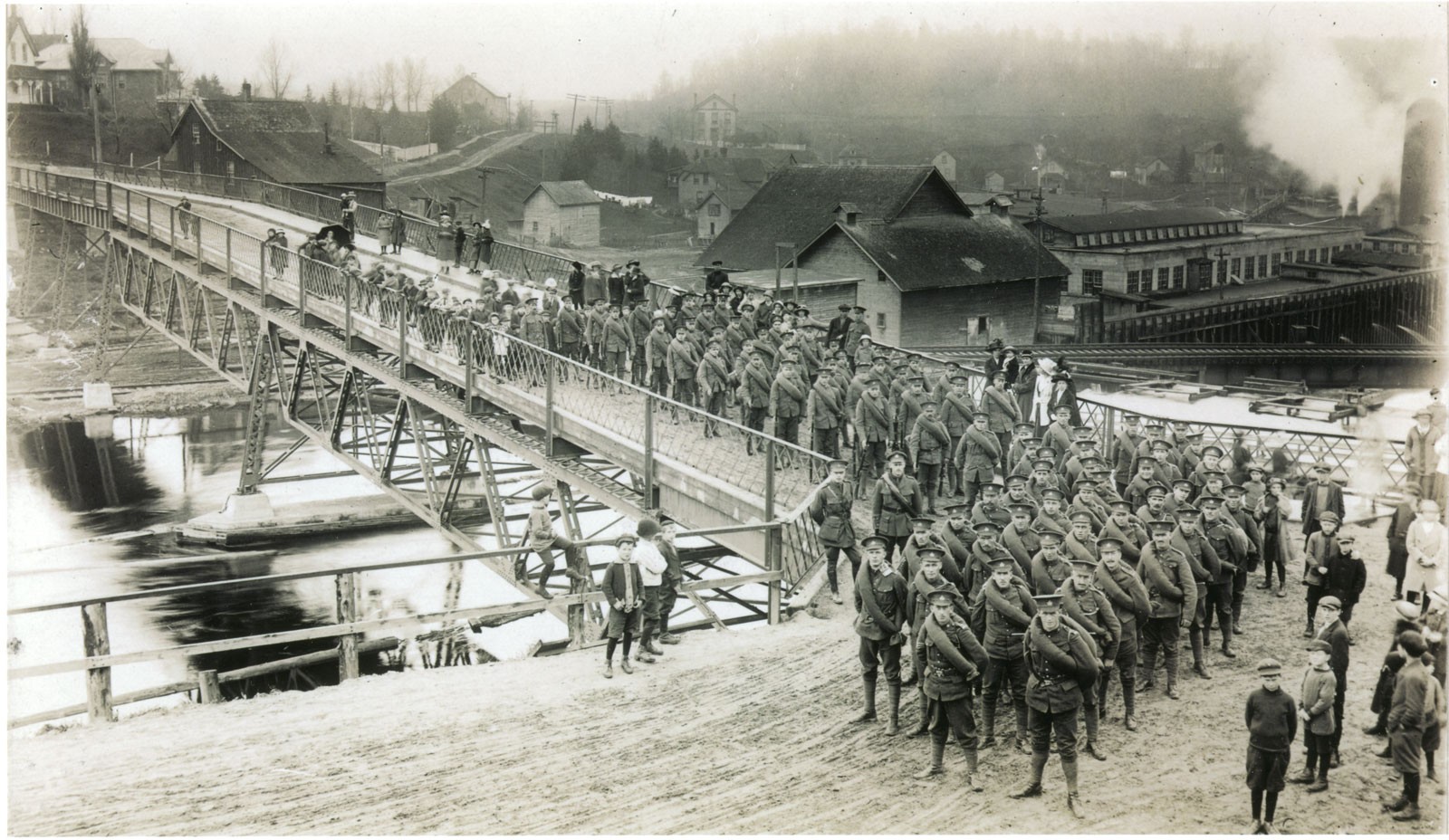 Women and children stand on the sidelines as a battalion marches through the town. <br>Courtesy the Sundridge - Strong Union Public Library.