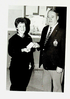 Photograph of a Legion Member and woman receiving cheque
