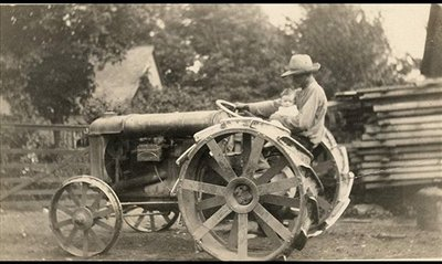 Cecil Norton with Son Grant on Fordson Tractor