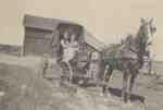 Mary and Dorothy Featherstone in a Carriage.