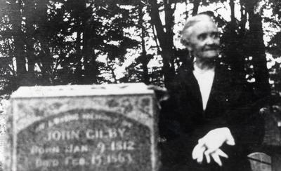 Emma Gilby Beside Her Father's Gravestone