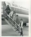 Marilyn Mills and 4-H Members Board Plane, 1970